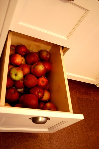 a drawer full of apples