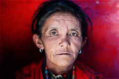 A Ladakhi Woman ( Poras Chaudhary) Tags: red india leh ladakh hemismonastery colorphotoaward mailciler ladakhiwoman alemdagqualityonlyclub