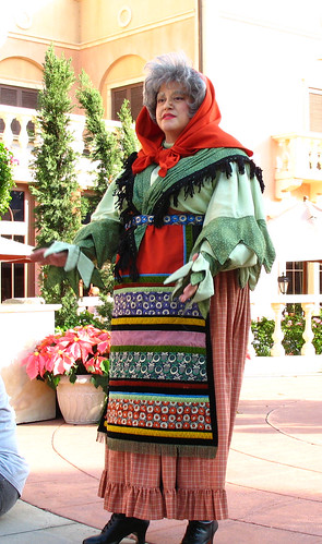 La Befana tells about Christmas tradition in Italy at the Italy Pavillion at Disney World's Epcot.