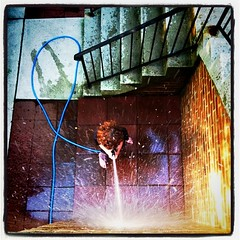 the boy and the hose (~Kerry Murphy) Tags: sunset water square hose squareformat seriousbusiness boychild lomofi iphoneography instagramapp uploaded:by=instagram