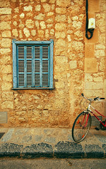 window (EddieMiller) Tags: blue summer window bike yellow stone spain pavement cable shutters shutter hdr majorca 2007 soller balearics nothdr