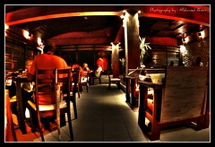 Sea House (Mohamed.Ahsan) Tags: wood light shadow red people orange woman plants brown man black tree glass lines yellow wall bulb umbrella chair colours chairs bright maroon sony ghost tiles maldives nite seahouse alpha700 shmpoo mohamedahsan