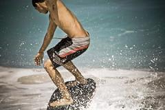kua bay005 (nia-briana) Tags: park boy beach hawaii bay day state sunny kai midair bigisland kona kailua kua skimboard kekaha micahm sandsliding niabriana