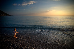 baba by the sea (flamed) Tags: ocean sunset italy baby holiday twilight italian europe liguria pebbles cinqueterre cinqueterra camogli portofino magichour italianriviera enchanged mywinners firstholiday