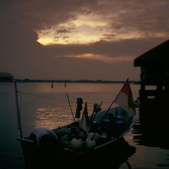 Last light by the jetty (89830026) (Fadzly @ Shutterhack) Tags: sunset film analog river catchycolors landscape boat fisherman jetty malaysia analogue terengganu kualaterengganu my leicar6 fadzlymubin shutterhack fujichromevelvia50rvp leicasummicronr35mmf2e55