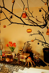 Mantle Asylum (1) (boopsie.daisy) Tags: flowers decorations tree halloween skull candles hand spiders pumpkins spiderweb books cobweb ornaments mantle spiderwebs cobwebs dollhead snowglobe aliceinwonderland halloweentree