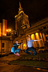 Double jump! (ole) Tags: city people orange building night french jump europe nightshot flash tripod culture poland polska wideangle palace soviet warsaw caughtintheact saut warszawa stalin varsovie jrmie pologne palaceofculture eole defidefiouiner ole kulturi lapoutre lapoutre2tek excapture europeanjumpproject jeremeole sautisme poutrin noticings creativecommonscentral