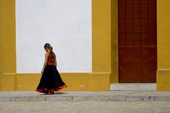 [ sevillana ] ([ chang ]) Tags: street door red people espaa color colour girl yellow person persona kid sevilla andaluca saturated spain rojo puerta colorful chica shot gente colores nia persone amarillo giallo porta colourful andalusia rosso gonna spagna joven bambina falda plazadetoros sevillana colorato saturo backsight wwwriccardoromanocom