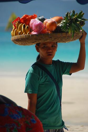 banana bilao onhead woman walking beach sea water snack fruit peddler banana saging pina piña pinay philippines walking filipinos philippines filipina pinoy pinay rural life