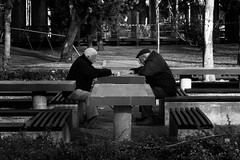 Reading the news (trazmumbalde) Tags: street people bw news portugal reading pessoas waiting europe rua matosinhos cy2 nikonstunninggallery challengeyouwinner youvsthebest thepinnaclehof