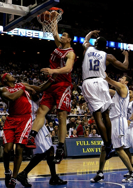 Yao Ming throws down a dunk over Orlando center Dwight Howard Friday night.  Yao finished with 26 points and 10 rebounds to lead the Rockets to a 96-94 victory.  He had plenty of help though, including Rafer Alston, Aaron Brooks, Luther Head and Luis Scola.