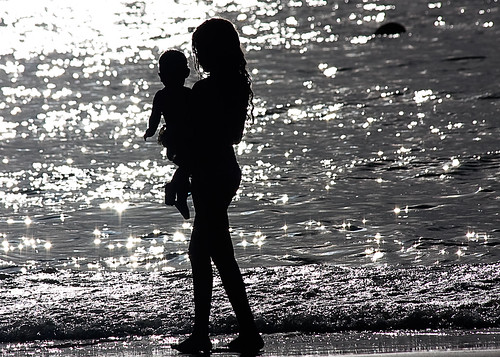 Black and White Silhouette of a girl and a baby boy