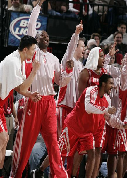 Yao Ming, Dikembe Mutombo, Luther Head and other Rocket players cheer on their teammates during the 4th quarter of a big win in Portland.  Yao only scored 11 points (but had 10 rebounds) as the Rockets ended the Blazers' 12-game home winning streak.