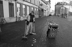 Street Sweeper - Striker-12 (My name's axel) Tags: street people urban blackandwhite closeup riot garbage nikon belgium debris utata shotgun filth streetsweeper garbageman welltaken d40 nikond40 rawstreet straatveger