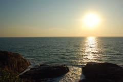 sunset (thejasp) Tags: travel sunset sea sun india tourism beach water d50 nikon scenery rocks tramonto sonnenuntergang sundown horizon kerala dslr ocaso indien 14000 trivandrum southindia keralam 18mm puestadelsol southasia   blazing   indiatravel    thiruvananthapuram indiatourism thejas vizhinjam  blazingsun   sdindien   zuidindia  llameante    phasefinale              suurindland