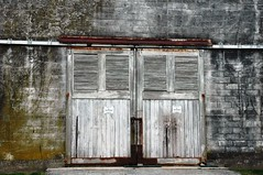 Siblings (alankin) Tags: 15fav rural buildings nikon doors pennsylvania decay d70s 1870mmf3545g pairs nikkor norristown weatheredwood flickrmeet flickrmeetup cinderblocks photostroll almostmonochromatic norristownfarmpark 40views niknala 19nov2006 easternpameetup20061119 1500294bmu