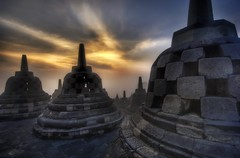 Caged Buddhas High in the Temple in Borobudur (Stuck in Customs) Tags: pictures lighting travel light panorama art texture colors lines birds modern composition sunrise work reflections painting indonesia temple photography java intense nikon perfect colorful asia exposure shoot artist mood photographer shot angle photos unique buddha background stupa buddhist details perspective atmosphere cage images best edge processing pro trips framing lovely jogjakarta capture tones hdr borobudur trey masterpiece treatment glamorous cages mostviewed highquality stuckincustoms borubudur barabudur treyratcliff