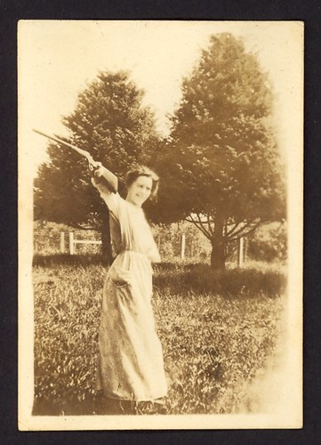 Snapshot: Woman with Shotgun