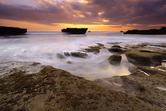 Symphony of the sea (tropicaLiving - Jessy Eykendorp) Tags: longexposure light sunset sea sky bali seascape motion beach nature water clouds canon indonesia landscape eos coast rocks action shoreline efs 1022mm echobeach canggu 50d outdoorphotography canoneos50d bwcpl tropicaliving hitechfilters vosplusbellesphotos symphonyofthesea rawproccessedwithdigitalphotopro tiffproccessedwithadobephotoshopcs3 hitechfilterndgrad