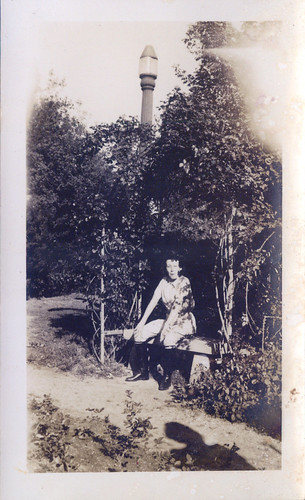 One woman in jodhpurs with street lamp