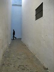 passerby (maximorgana) Tags: blue white black window fotosencadenadas wall bar walking spain pavement eu fotolog lane cadiz vejer vejerdelafrontera aplusphoto passeby