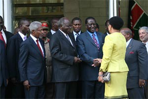 ODM leader Raila Odinga stands next to President Kibaki as he shakes hands with mediator Graca Machel. Photo/JOSEPH MATHENGE by Pan-African News Wire File Photos