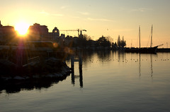 explosion in a harbor (olszuffka) Tags: sun france water port harbor harbour evianlesbains
