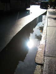 waiting for the bus (pondblue) Tags: nyc sun sunlight white black water puddle waiting sidewalk colorcolor  ayoc2