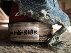 Worn (kristen_crewe) Tags: jeans converse torn