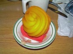Orange sherbet on strawberry pie