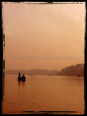 """Quelques Mots D'amour"" (designldg) Tags: sunset india water sepia boat colours perspective dream varanasi shanti soe ganga ganges benaras uttarpradesh  indiasong ysplix hourofthediamondlight"