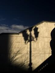 Sombras nada mas (Espejo Eterno) Tags: blue shadow cloud azul dark arbol spain farola sombra olympus bilbao cielo ria nube rama