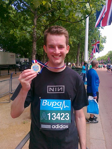10k man with his medal by philippa_moore
