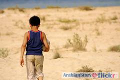 Beach Play (Ageel Al-Shayeb) Tags: boy sea beach children saudiarabia alahsa easternregion oqair