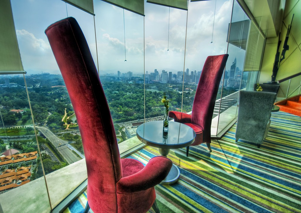 The Electric Red High-Backed Chairs where I Eat Breakfast in Kuala Lumpur