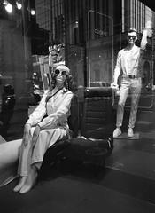 Cockpit (Georgie_grrl) Tags: mannequins windowdisplay thebay pentaxk1000 rikenon12828mm toronto ontario blackandwhite monochrome jchstreetpan400 cockpit pilot flightattendant bringmealatteplease shades sunglasses headphones