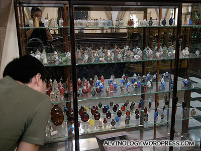 Jeremy examining the snuff bottles in detail