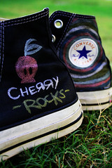 my new/old converse =P (S) Tags: black green colors grass cherry skull shoes rocks converse allstar