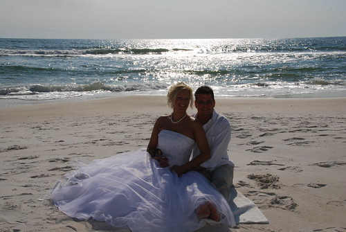 Beach wedding with the glimmer of the sun by destin beach weddings.