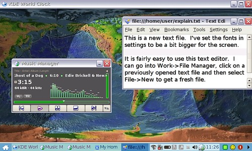 Text Editor Used with Music Manager and World Clock in Background
