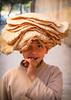 Bread Head 2 (hazy jenius) Tags: world street city trip travel boy portrait people urban food kids children natural middleeast backpack cannon syria