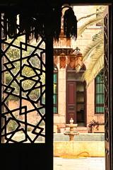 Inside the Khan (hazy jenius) Tags: world street door city trip travel urban window fountain lamp silhouette architecture design view muslim islam middleeast courtyard arab syria khan damascus oldcity cham dimashq ashsham globalbackpack
