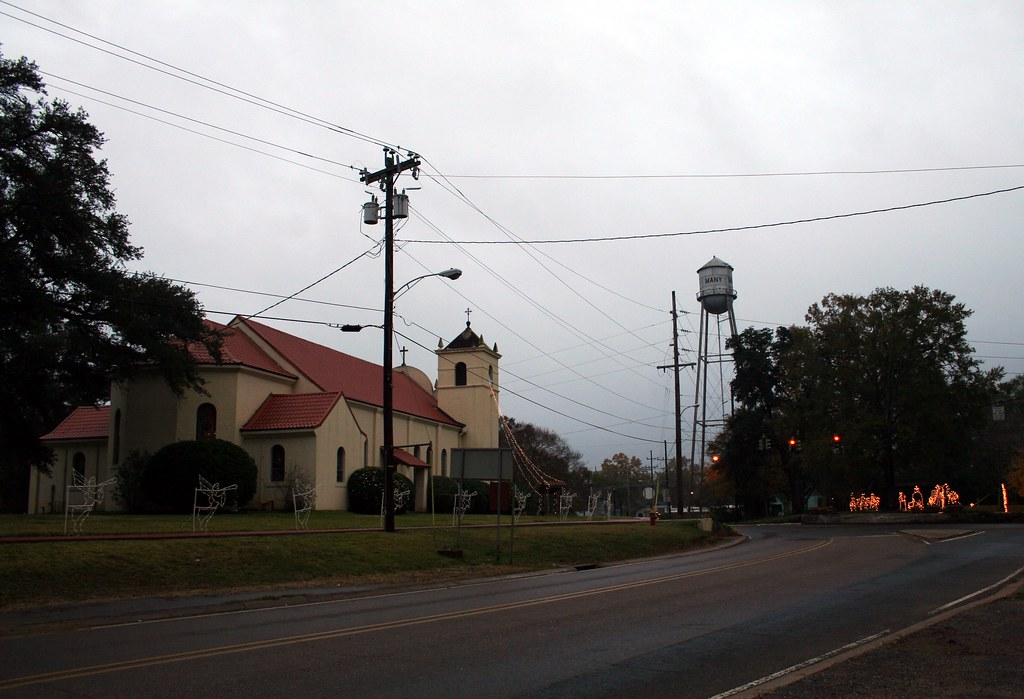 st. john the baptist catholic church and many water tower