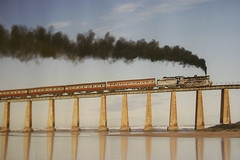 Outeniqua Choo-Tjoe ( South Africa) : Old romantic steamlocomotive on bridge along the Indian Ocean (dirk huijssoon) Tags: africa bridge train george south steam explore locomotive steamengine railwaybridge steamlocomotive zuidafrika outeniqua chootjoe 5photosaday outeniquachootjoe diamondclassphotographer flickrdiamond