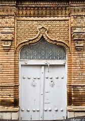 An old door (kavan.) Tags: door brick history yellow architecture canon design ancient pattern iran sigma adobe historical iranian 1770 kurdistan basrelief sanandaj kavan kordestan 400d woodydoor
