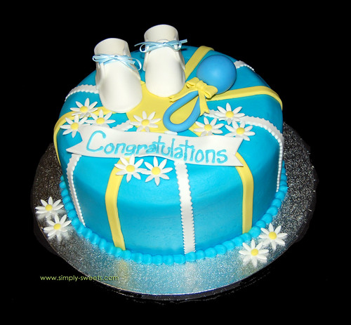 Baby Boy shower cake with rattle and booties