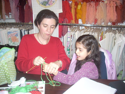 Mom teaches Abigail to knit