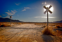 Sun and Signs (sandy.redding) Tags: california railroad blue landscape desert blogged def honorablemention explored nikkor1855mmf3556g impressedbeauty flickrplatinum goldstaraward 7pointsystemforphotoshop desertempirefair2008