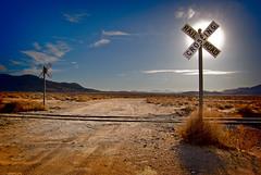 Sun and Signs (sandy.redding) Tags: california railroad blue landscape desert blogged def honorablemention explored nikkor1855mmf3556g impressedbeauty flickrplatinum goldstaraward 7pointsystemforphotoshop desertempirefair2008