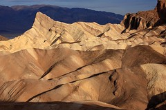 Sunrise at Zabriskie Point [7147] (Steven Christenson) Tags: sunrise landscape photo nationalpark desert cinnamon manly hills erosion deathvalley zabriskiepoint potm manlybeacon potm2008 xyzzyviewtest